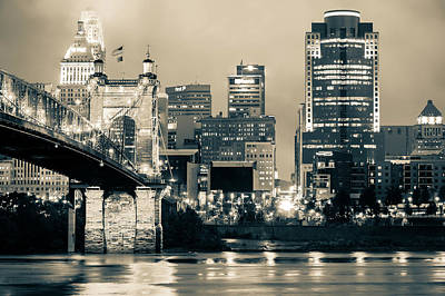 Cincinnati Skyline And The John A. Roebling Suspension Bridge - Sepia Print by Gregory Ballos
