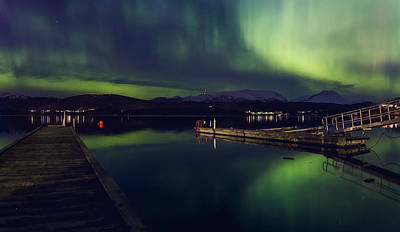 Noruega Photograph - City Lights Can't Stop The Northern Lights by Iwan Groot