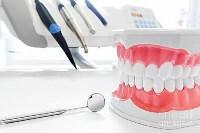 Mirror Photograph - Clean Teeth Dental Jaw Model, Mirror And Dentistry Instruments In Dentist's Office by Michal Bednarek