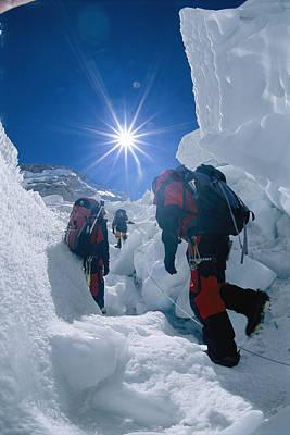 Climbers Ascend The Khumbu Ice Fall Print by Bobby Model