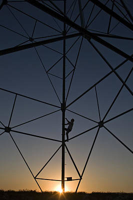 Telephone Poles Photograph - Climbing Up A Tower by Dawn Kish
