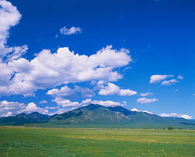 Taos New Mexico Photograph - Clouds Over A Mountain Range, Taos by Panoramic Images