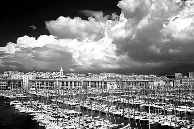 Clouds Rolling In Over The Port Print by John Rizzuto