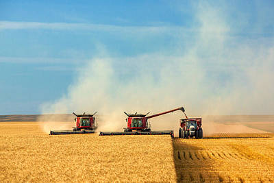 Combines And Tractor Working Together Print by Todd Klassy