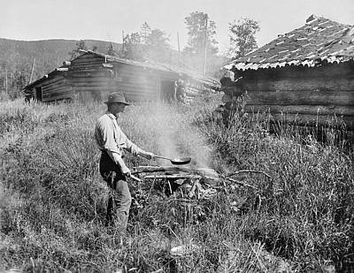 Log Cabin Photograph - Cooking Over A Campfire by Underwood Archives