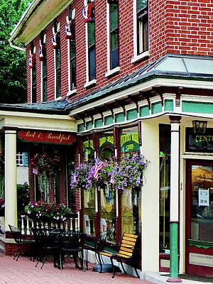 Baskets Photograph - Corner Restaurant With Hanging Plants by Susan Savad
