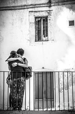 Couple Of Guys Hugging Leaning On A Railing - Black And White With Vignetting Print by Luca Lorenzelli