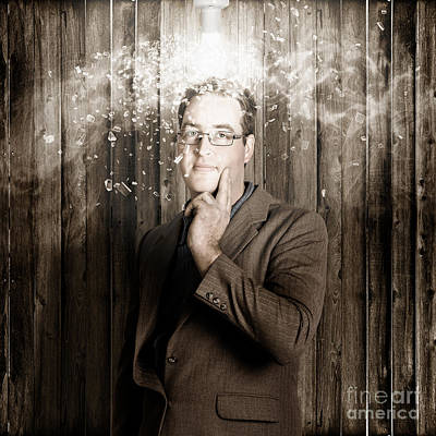 Creative Business Man With Bright Light Bulb Idea Print by Jorgo Photography - Wall Art Gallery