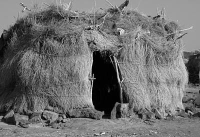 Faces And Places Photograph - Danakil Settlement, East Africa by Aidan Moran