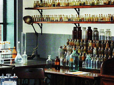 Chemistry Photograph - Desk With Bottles Of Chemicals by Susan Savad