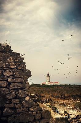 Distant Lighthouse Print by Carlos Caetano