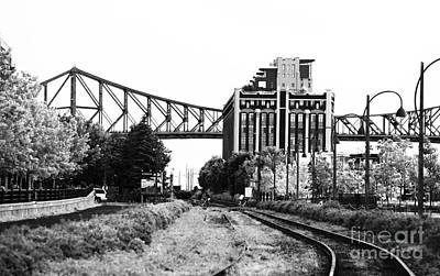 Old Montreal Photograph - Down The Tracks by John Rizzuto