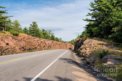 Rock Photograph - Driving Through A Road Rock Cut by Les Palenik