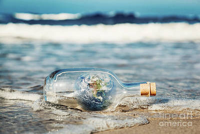 Protection Photograph - Earth In The Bottle Coming With Wave From Ocean. Environment, Clean World Message by Michal Bednarek