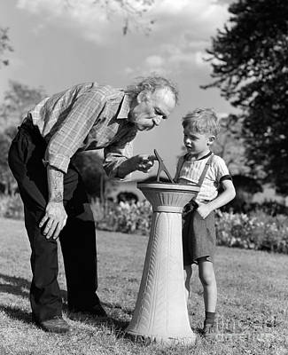 Elderly Man Explaining Sundial To Boy Print by H. Armstrong Roberts/ClassicStock