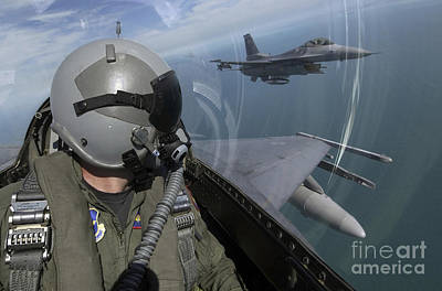 F-16 Fighting Falcons Flying Print by Stocktrek Images