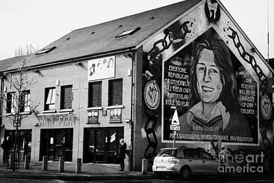 Mural Photograph - falls road sinn fein headquarters with bobby sands mural Belfast Northern Ireland  by Joe Fox