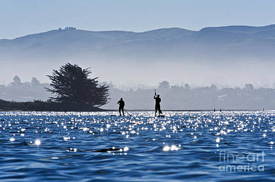 Faraway Paddle Boarders In Morro Bay Print by Bill Brennan - Printscapes