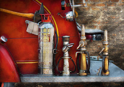 Photograph - Fireman - An Assortment Of Nozzles by Mike Savad
