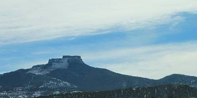 Fishers Peak Raton Mesa In Snow Print by Christopher Kirby