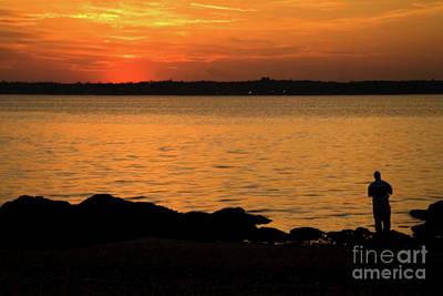 Fishing At Sunset Print by Karol Livote