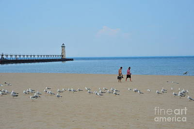 Fishermen Photograph - Fishing With The Seagulls At The Manistee Lighthouse by Terri Gostola