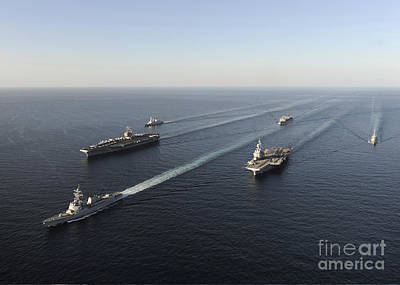 Foreign Military Photograph - Fleet Of Navy Ships Transit The Arabian by Stocktrek Images