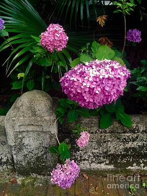 Photograph - Flowers And Stone by Robin Lewis