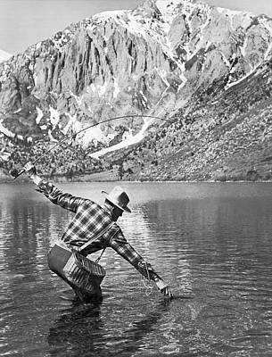 Angling Photograph - Fly Fishing In A Mountain Lake by Underwood Archives