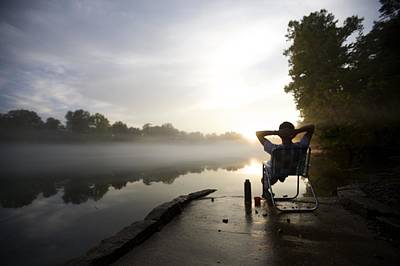 Lawn Chairs Photograph - Foggy Riverside Landscape At Sunset by Gillham Studios