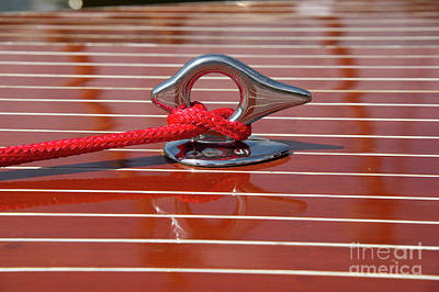 Marine Photograph - Red Line And Chrome Foredeck Cleat On Classic Runabout Boat by Mark Roger Bailey