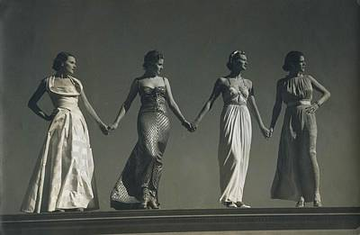 Ball Gown Photograph - Four Models Standing, Holding Hands by Conde Nast