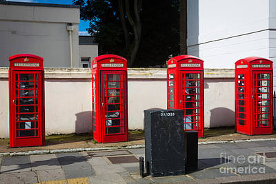 Four Phone Booths In London Print by Inge Johnsson