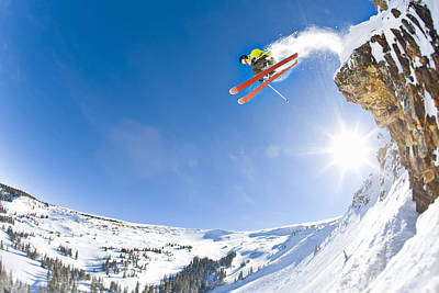 Sports Photograph - Freestyle Skier Jumping Off Cliff by Tyler Stableford