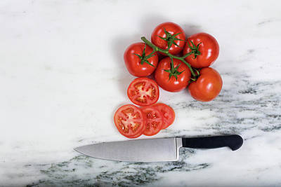 Freshly Sliced Tomatoes On Natural Marble Stone Background  Print by Thomas Baker