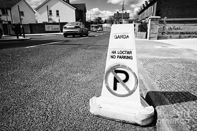 garda no parking traffic cones on a street in Clones county monaghan republic of ireland Print by Joe Fox