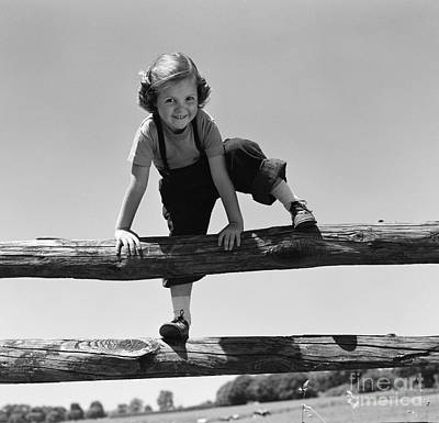 Tomboy Photograph - Girl Climbing Over Wooden Fence by H. Armstrong Roberts/ClassicStock
