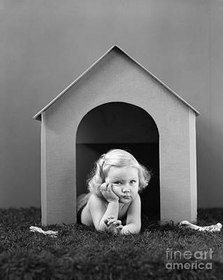 Girl In Dog House, C.1940s Print by H. Armstrong Roberts/ClassicStock