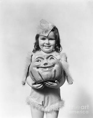 Paper Mache Photograph - Girl In Halloween Costume, C.1930-40s by H. Armstrong Roberts/ClassicStock