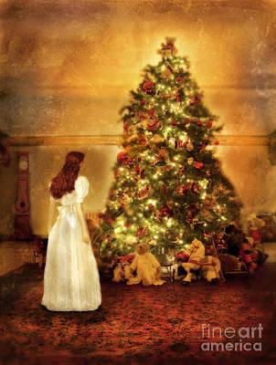 Girl Standing In Wonder By Christmas Tree Print by Jill Battaglia