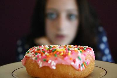 Girl With Doughnut Print by Linda Woods