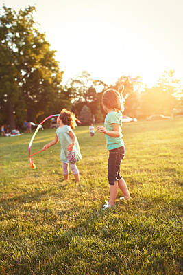 Looking Away From Camera Photograph - Girls Playing Together On Evening Lawn by Gillham Studios