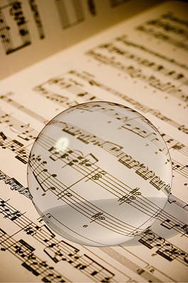 Glass Ball On Sheet Music Print by Utah Images