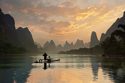 Fishermen Photograph - Golden Li River by Yan Zhang