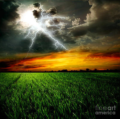 Green Grass Against A Stormy Sky Print by Unknow