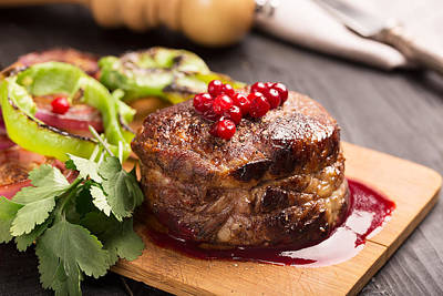 Grilled Steak Meat On The Wooden Surface Print by Vadim Goodwill