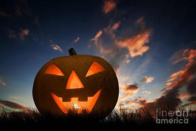 Halloween Pumpkin Glowing Under Dark Sunset, Night Sky. Jack O'lantern Print by Michal Bednarek