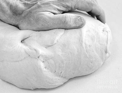 Bread Making Photograph - Hands Of A Baker Kneading Dough by Oren Shalev
