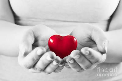 Emotion Photograph - Heart In Woman Hands by Michal Bednarek