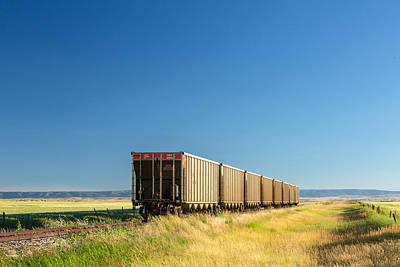 Wagon Train Photograph - Hopper Row by Todd Klassy